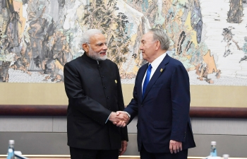 Prime Minister Modi meets President Nazarbayev on the sidelines of SCO Summit